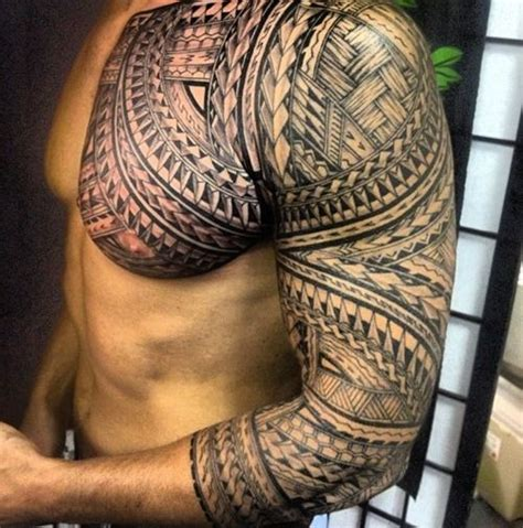 tribal chest n sleeve tattoos