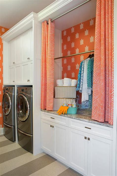 stacked washer dryer cabinet enclosures hicks hexagon wallpaper transitional laundry room