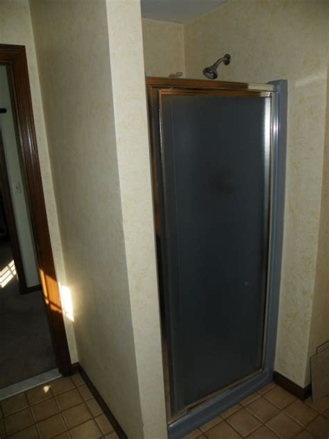 Fiberglass Walk In Shower by Outdated Fiberglass Shower Transformed To New Walk In