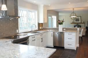 snow white quartz countertop on painted white cabinets