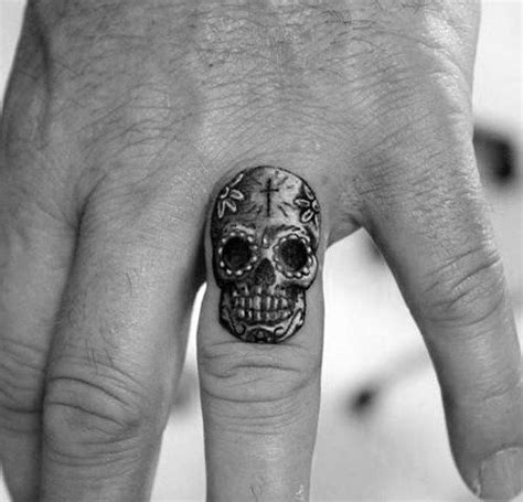 finger tattoo designs for guys 50 small skull tattoos for men mortality design ideas