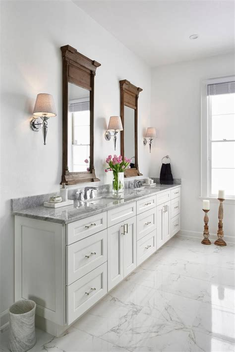 White Marble Bathroom Countertops by This Traditional White Master Bathroom Features White