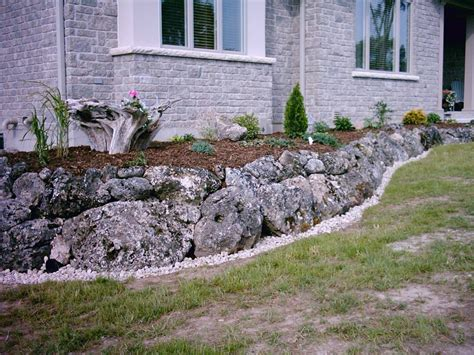 nice Small Beds For Small Rooms #3: rustic-style-stones-for-flower-beds.jpg