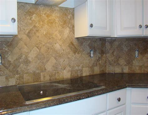 travertine herringbone backsplash i this