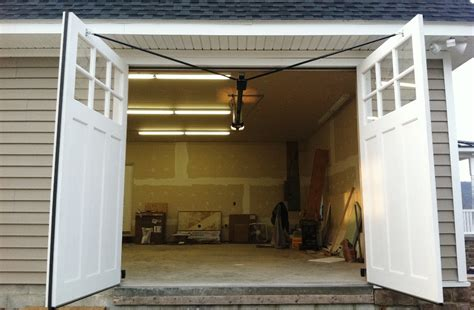 how to build swing out garage doors automatic swing out garage doors garage carriage style