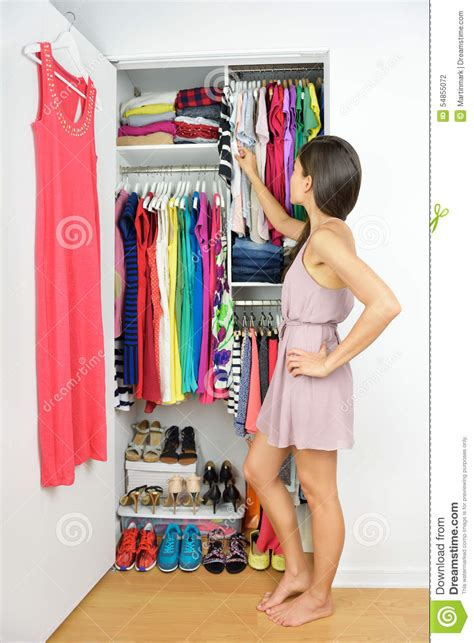 Closet Shopping by Home Closet Choosing Fashion Clothing Stock