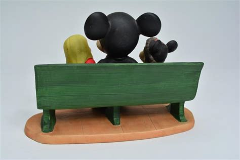 mickey mouse work bench mickey mouse and children on park bench ceramic figurine ret