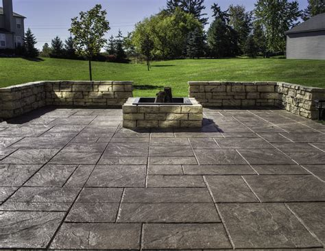 How To Lay A Patio On Concrete by Sted Concrete Michigan Landscaping Company