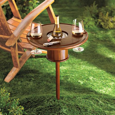 outdoor wine glass holder table staked mahogany lawn table with bottle cooler the green