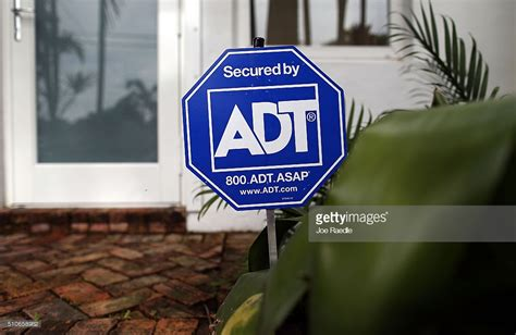 adt acquired by equity firm apollo global