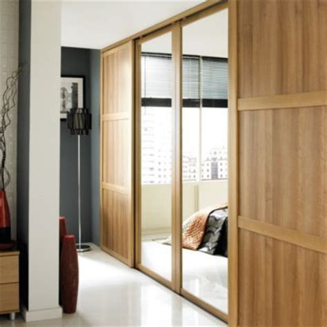 Wall Fitted Wardrobes by B Q Mirrored Sliding Wall To Wall Wardrobe Door Oak Effect