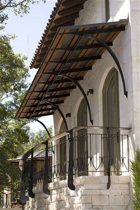 wrought iron awning brackets things that inspire design element metal and canvas awnings