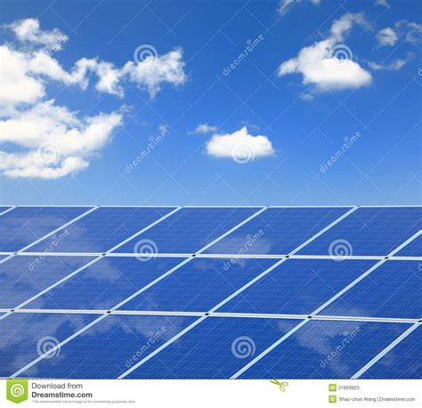 solar panel with reflection of blue sky and white stock