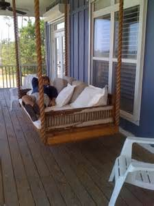 hanging day bed made from antique shutters traditional