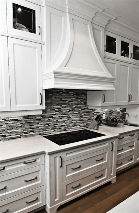 backsplash ideas for grey countertops gorgeous kitchen with crisp white cabinetry marble