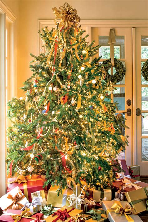 how to put garland on a tree new ideas for tree garland southern living