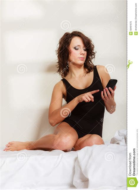sexy in bed lazy girl with mobile phone on bed in bedroom stock image image 58491675