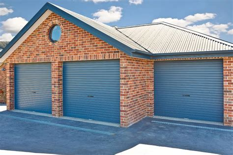 How Much Is A Roller Garage Door by How Much Does A Brick Garage Cost