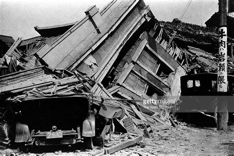 earthquake tokyo a car and a house are squashed by the great kanto