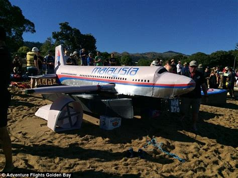 cardboard boat sinking new zeland man and his sons sink mh370 model to win