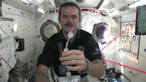 how do they use the bathroom in space amazing science how do astronauts drink in space