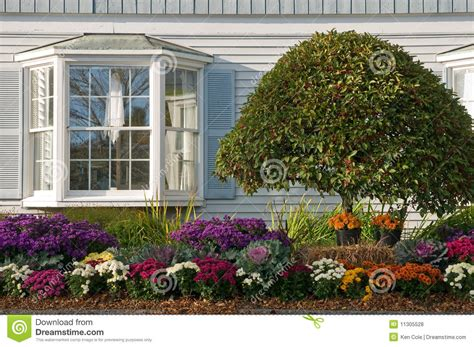 Flower Beds Around House Landscaping Near Bay Window Royalty Free Stock Photos