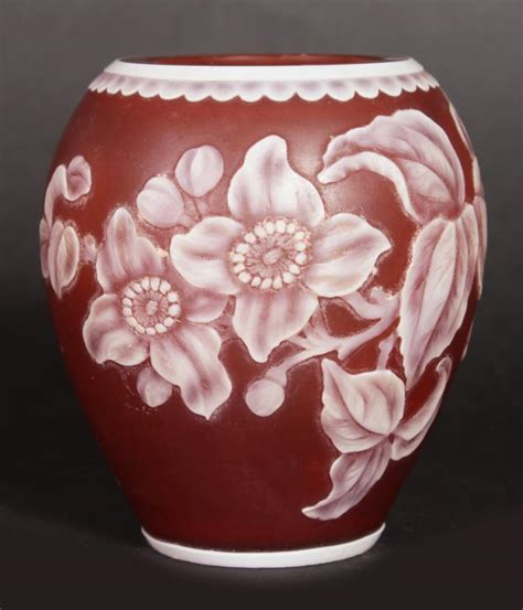 a small webbs cameo pink vase with flowers in cameo 2 75ins