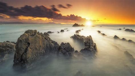 sunset rocky mountain peaks fog vapor orange sky desktop