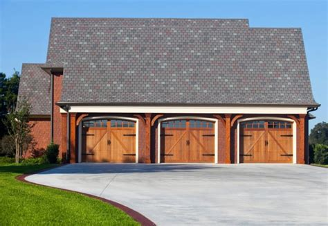 3 car red barn style garage everyone s must have craftsman style garage door decohoms