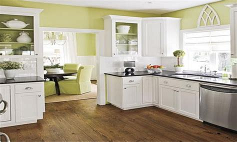white kitchen cabinets with stainless steel appliances choosing paint color kitchen wall green