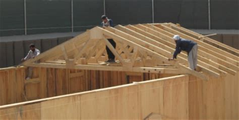 Partition House by Roof Truss Construction
