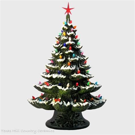 green ceramic christmas tree with snow color lights star