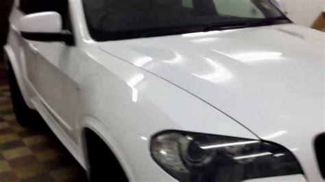 white pattern vinyl wrap bmw x5 gloss white vinyl wrap by wrapping cars london
