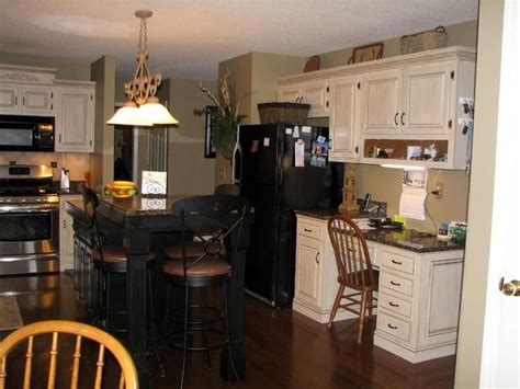 off white kitchen cabinets with stainless appliances mixing stainless and black appliances for the home
