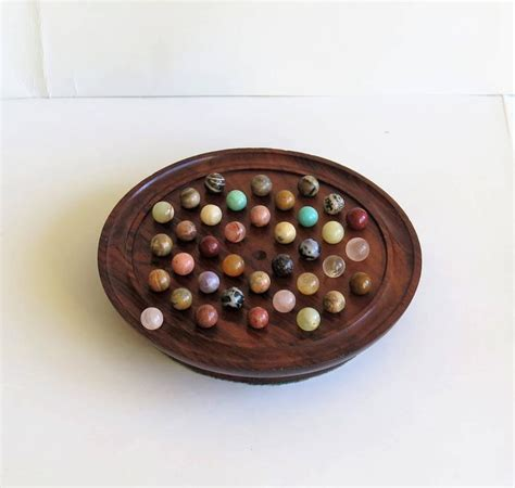 Handmade Marbles For Sale - 19th century solitaire marble board 37 early
