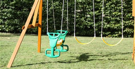 swing features windale climbing frame and slide with swings rock wall