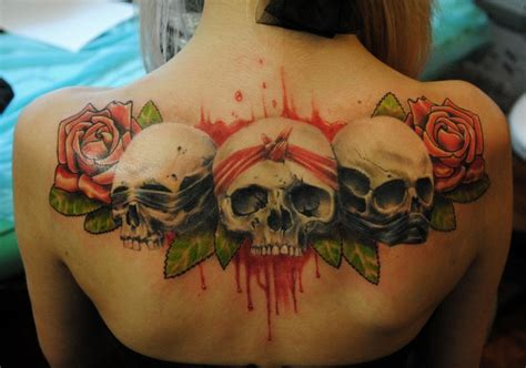 rose tattoo on upper back new school style colored back of skulls with
