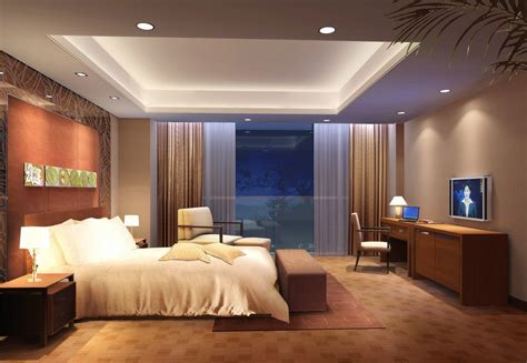 Luxurious tray master bedroom ceiling with led recessed lighting in a bedroom with brown