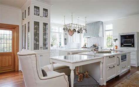 marble top dining table next to kitchen island