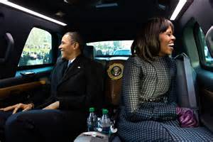 the obama s file obamas wave from the presidential limousine jpg