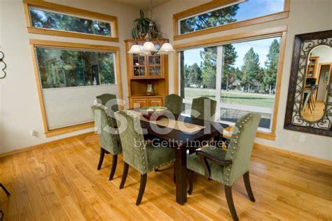 modern dining room  large windows stock
