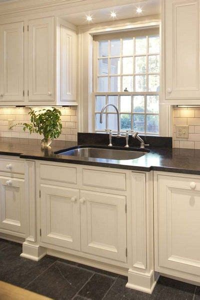 over the kitchen sink lighting kitchen cleanup station traditional kitchens kitchens