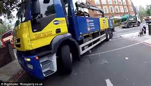 the last lorry a video shows motorcyclist colliding with lorry and leaping off at the last moment daily mail online