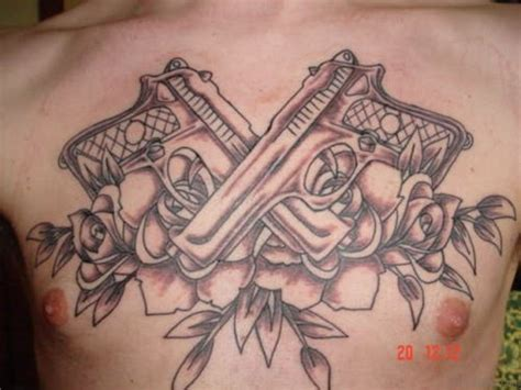 gun with roses tattoos 85 mind blowing tattoos on chest