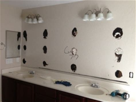 how to glue a bathroom mirror to the wall how to repair a large sinking bathroom double sink vanity