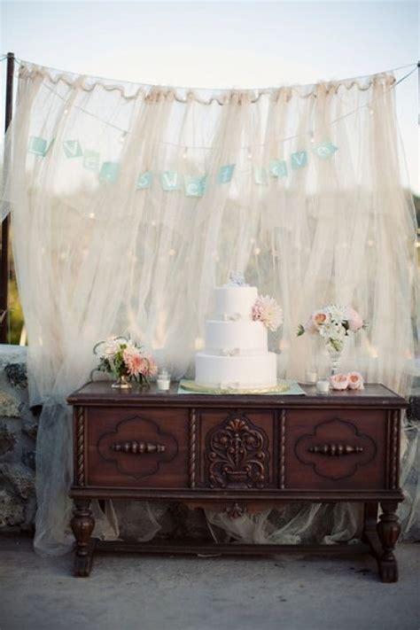 cake table the flowy backdrop weddings