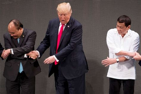 donald trump handshake president trump appears to be caught off guard by asean