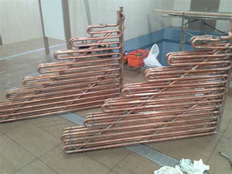 Attic Pool Heat Exchanger - how to calculate btu output of each ft of copper pipe or