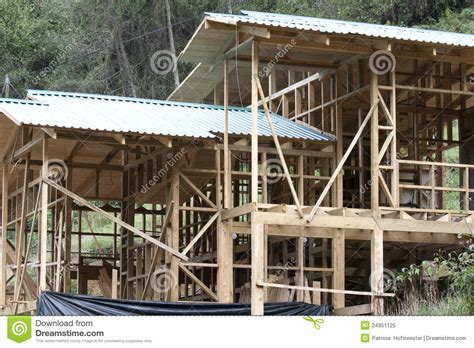 Building Of A Wooden House On A Slope Royalty Free Stock