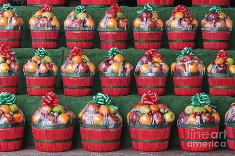 christmas fruit baskets on shelves photograph by jeremy